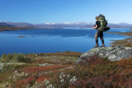 long distance Hiker over a lake in the north of sweden © Jens Ottoson - Fotolia.com